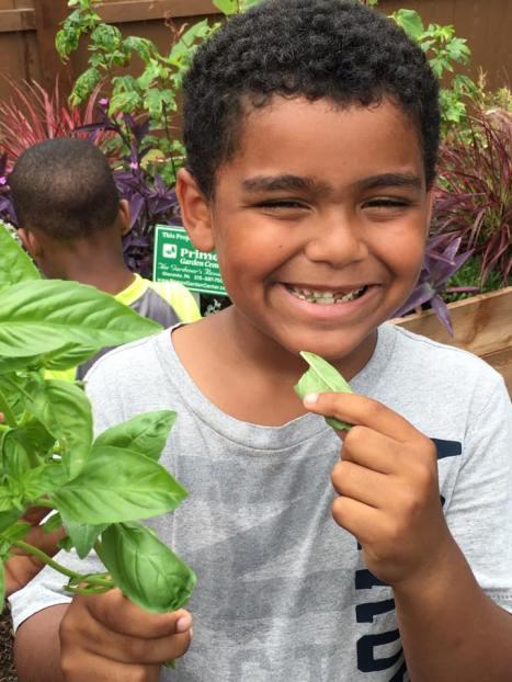 smiling-child-in-garden